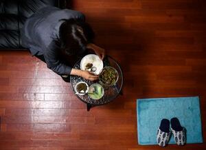 3回目の難民申請中で、強制送還におびえるセンさん(仮名)。一家6人での食事が人生で一度もできぬまま、両親は他界した=13日、東京都新宿区