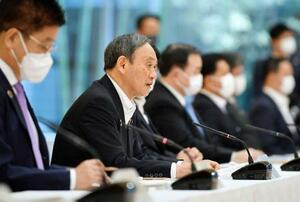 「持続可能な開発目標(SDGs)」実現を目指す推進本部の会合で発言する菅首相=22日午前、首相官邸