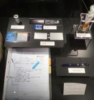 ノーベル博物館に寄贈された旭化成名誉フェロー吉野彰さんのリポートのコピーなどの品=スウェーデン・ストックホルム(旭化成提供)