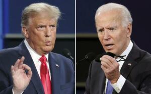 22日、米テネシー州ナッシュビルで開かれた2回目の候補者討論会で発言するトランプ大統領(左)とバイデン前副大統領(ゲッティ=共同)
