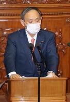 衆院本会議の代表質問で答弁する菅首相=20日午後